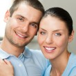 Young happy smiling attractive couple at home — Stock Photo #58887319