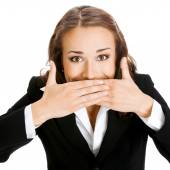 Happy businesswoman covering mouth, isolated  — Stock Photo