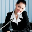 Businesswoman on phone signing document at office — Stock Photo #61382699