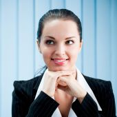 Closeup of thinking or dreaming businesswoman at office — Stock Photo
