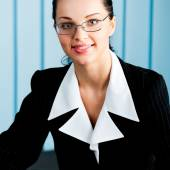 Happy smiling businesswoman at office — Stock Photo