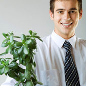 Businessman or student with flowerpot — Stock Photo