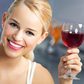 Woman with glass of redwine — Stock Photo
