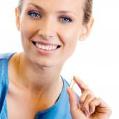 Woman with Omega 3 fish oil capsule — Stock Photo