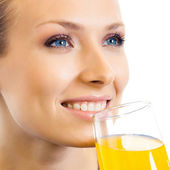 Woman drinking orange juice, over white — Foto Stock