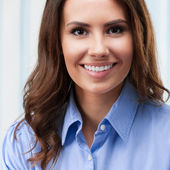 Cheerful young businesswoman at office — Stock Photo