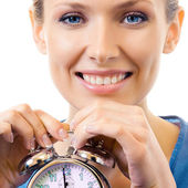 Woman with alarmclock, isolated — Stock Photo