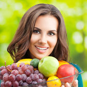 Young woman with fruits, outdoor — Stock Photo