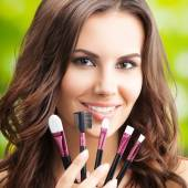 Young woman with make up tools, outdoor — Stock Photo