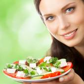 Young woman with plate of salad — Stock Photo