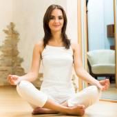 Woman doing yoga exercises, indoors — Stockfoto
