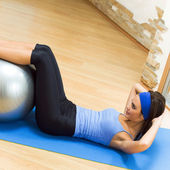 Woman doing exercises with fit ball — Stock Photo