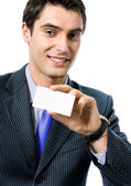Businessman giving businesscard or bank card — Stock Photo