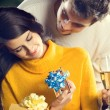 Portrait of young happy couple with gifts, outdoor — Stock Photo #63511495