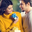 Portrait of young happy couple with gifts, outdoor — Stock Photo #63511505