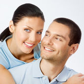 Cheerful amorous young couple, on grey — Stock Photo