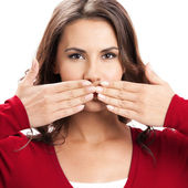 Young woman covering mouth, on white — Stock Photo