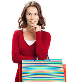 Beautiful woman in red casual clothing with shopping bags — Stock Photo