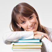 Cheerful smiling young woman with textbooks — Stock Photo