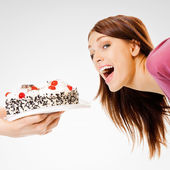 Young woman eating pie — Stock Photo