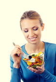 Cheerful young woman with vegeterian salad — Stock Photo
