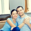 Cheerful smiling young attractive couple, indoors — Stock Photo #65023799