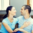 Cheerful smiling young attractive couple, indoors — Stock Photo #65023821