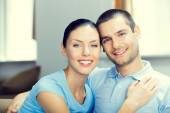 Cheerful smiling young attractive couple, indoors — Stock Photo