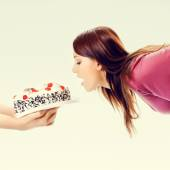Portrait of beautiful woman eating pie — Stock Photo