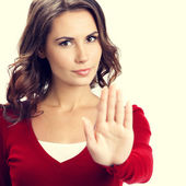 Young serious woman with stop gesture — Stock Photo
