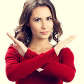 Portrait of serious woman showing stop or reject gesture — Stock Photo