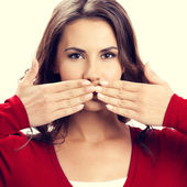 Portrait of beautiful woman covering with hands her mouth — Stock Photo