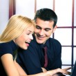 Two young businesspeople working with laptop — Stock Photo #68859337