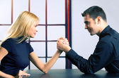 Couple or two businesspeople fighting in arm wrestling — Stock Photo
