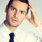 Shocked young male businessman — Stock Photo