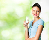 Smiling woman with glass of water, outdoor — Stock Photo