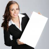 Businesswoman with signboard, on grey — Stock Photo
