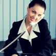 Businesswoman with phone signing document — Stock Photo #71032329