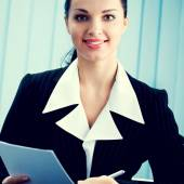 Happy businesswoman at office — Stock Photo
