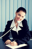 Businesswoman with phone signing document — Stock Photo