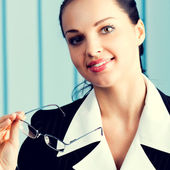 Happy smiling brunette businesswoman at office — Stock Photo
