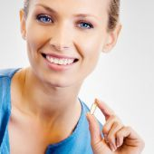 Young woman with Omega 3 fish oil capsule — Stock Photo