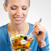 Happy smiling woman with salad — Stock Photo