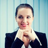 Thinking or dreaming businesswoman — Stock Photo