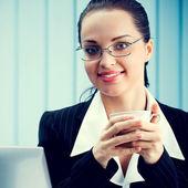 Businesswoman with coffee  — Stock Photo