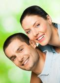 Portrait of happy smiling attractive couple — Stock Photo