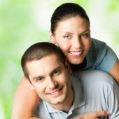 Portrait of happy smiling attractive couple, outdoors — Stock Photo