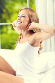 Young beautiful woman waking up — Stock Photo