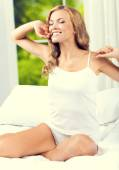 Blond woman waking up, at bedroom — Stock Photo