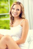 Young beautiful smiling woman waking up — Stock Photo
